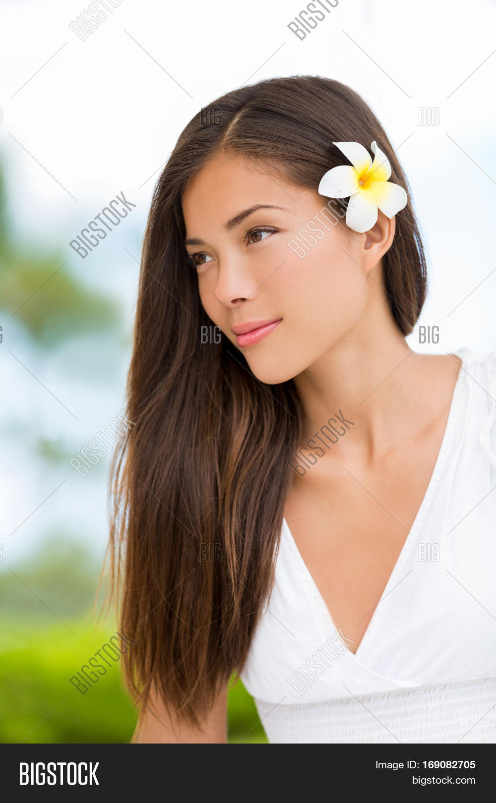 Asian mixed race beauty woman image photo bigstock asian mixed race beauty woman with healthy hair wearing hawaiian flower wellness skincare happy lifestyle izmirmasajfo Image collections