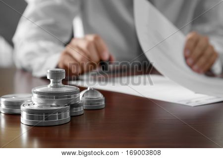 Metal ink pads and stamp on notary public table