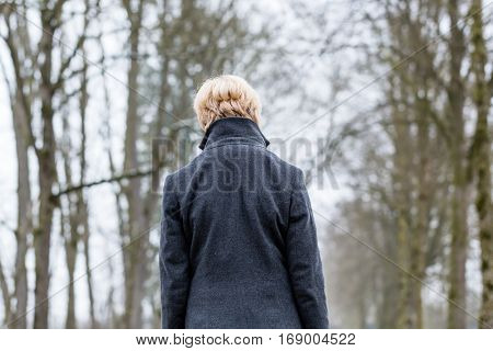 Unhappy woman having walk in winter
