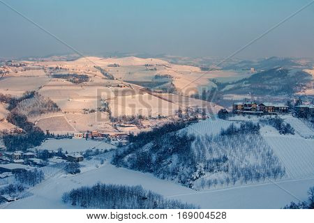 Hills and vineyards of Langhe covered with snow in Piedmont, Northern Italy.
