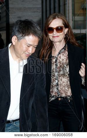 NEW YORK, NY-JUL 30: Actress Isabelle Huppert (R) arrives at the Walter Reade Theater for