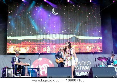 LAS VEGAS-SEP 20: Country music singer Kacey Musgraves (C) performs in concert at the 2014 iHeartRadio Music Festival Village Show at MGM Resorts Village on September 20, 2014 in Las Vegas, Nevada.