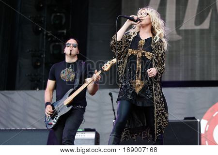 LAS VEGAS-SEP 20: Singer Taylor Momsen (R) and Mark Damon of The Pretty Reckless perform in concert at the iHeartRadio Music Festival at MGM Resorts Village on September 20, 2014 in Las Vegas, Nevada.