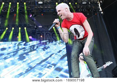 LAS VEGAS-SEP 20: Tyler Glenn of Neon Tress performs in concert at the 2014 iHeartRadio Music Festival Village Show at MGM Resorts Village on September 20, 2014 in Las Vegas, Nevada.