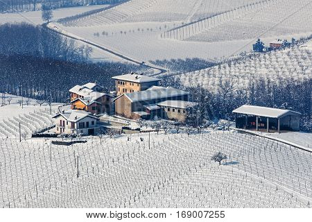 Small hamlet on snowy hill in Piedmont, Northern Italy.