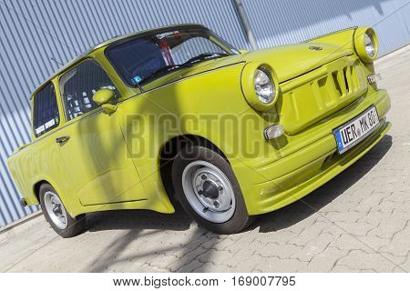 ALTENTREPTOW / GERMANY - MAY 1 2015: german tuned trabant car stands near a hall at oldtimer show on may 1 2015 in altentreptow germany.