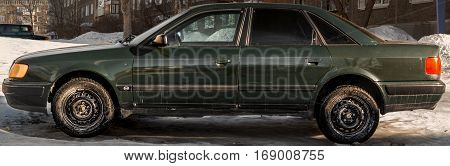 Kazakhstan, Ust-Kamenogorsk, 25 january 2017: Audi 100 C4, side view, green car