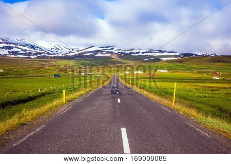 Summer tour in the Nordic countries. The concept of extreme northern tourism. The Iceland  highway in Tundra