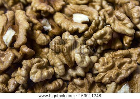 Closeup of Peeled Walnuts Pile. Walnuts Background. Many Different Textured Walnuts.