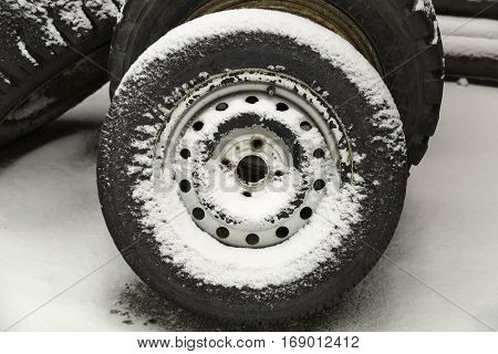 Tire Covered in Snow close up image.