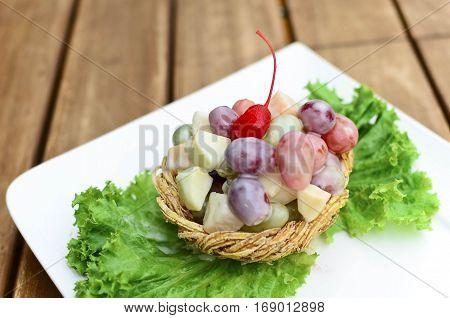 Closeup fruit salad with shrimp and fresh vegetable