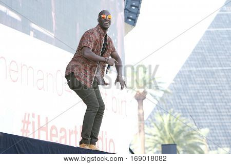 LAS VEGAS-SEP 20: Singer Vincent Dery aka Vinz of Nico and Vinz performs in concert at 2014 iHeartRadio Music Festival Village Show at MGM Resorts Village on September 20, 2014 in Las Vegas, Nevada.