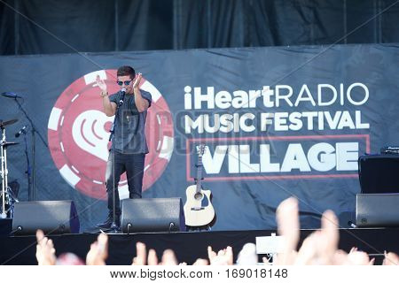 LAS VEGAS-SEP 20: Rapper Jake Miller performs in concert at the 2014 iHeartRadio Music Festival Village Show at MGM Resorts Village on September 20, 2014 in Las Vegas, Nevada.