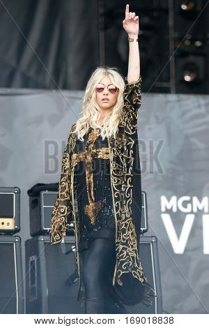 LAS VEGAS-SEP 20: Singer Taylor Momsen of The Pretty Reckless performs in concert at the 2014 iHeartRadio Music Festival Village Show at MGM Resorts Village on September 20, 2014 in Las Vegas, Nevada.