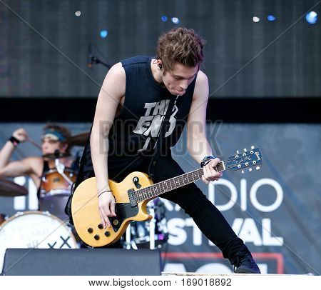 LAS VEGAS-SEP 20: Musician Luke Hemmings of 5 Seconds of Summer performs at the 2014 iHeartRadio Music Festival Village Show at MGM Resorts Village on September 20, 2014 in Las Vegas, Nevada.
