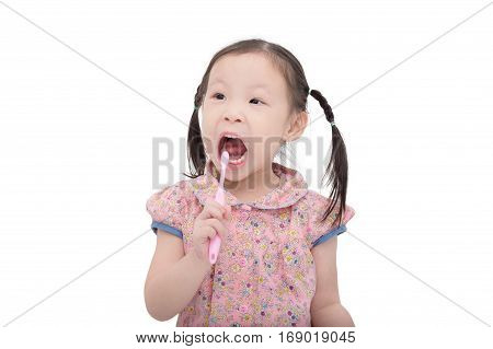 Little asian girl cleansing her teeth by toothbrush over white background