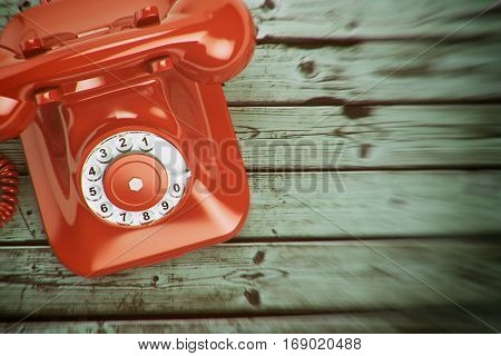 Vintage retro telephone on the wood background. 3d illustration