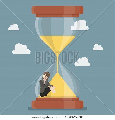 Business woman stuck in sandglass. Business deadline concept