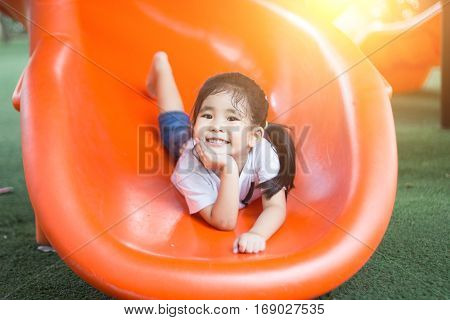 Asian Girl Play On Playground