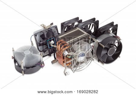 Several various active CPU coolers with fans and computer fans different sizes for use in a computer case on a light background
