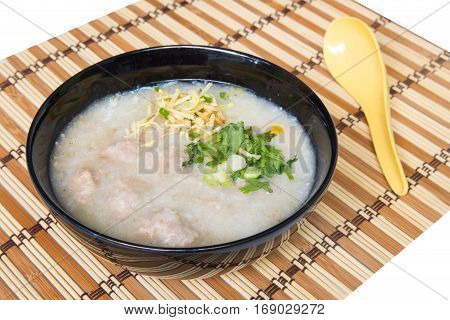 Congee Rice porridge Rice gruel Rice soup on wooden background.