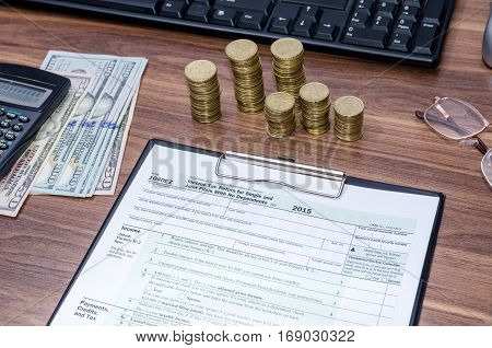 1040Ez Income Tax Form With Money, Pen On Table