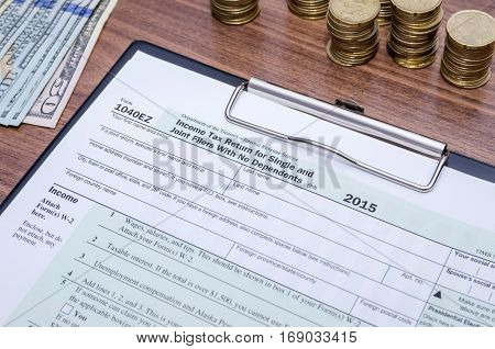 Us Federal Income 1040 Tax Return Form With Money And Pen