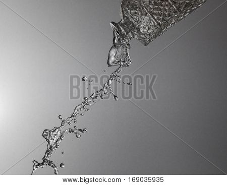 Texture of water on a silver background, similar to the liquid metal and decanter