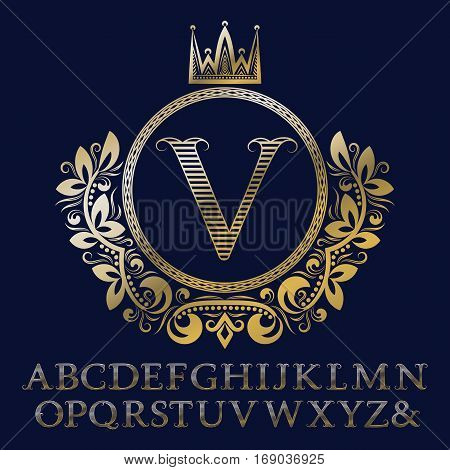 Striped gold letters and initial monogram in coat of arms form with crown. Royal font and elements kit for logo design.