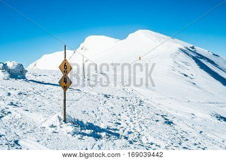 Way on snowy mountains, winter mountain trail, european tour in snowy mountains, symbol of winter mountains
