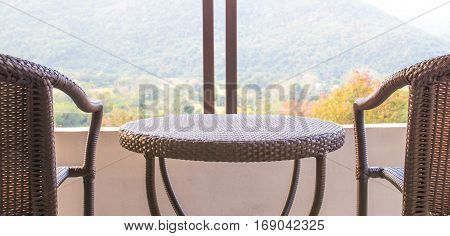 rattan of table and chair on balcony