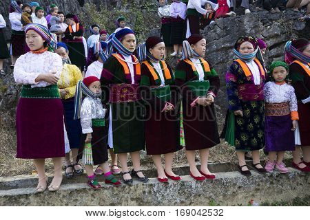 Ha Giang, Vietnam - Feb 7, 2014: Unidentified group of Hmong people watching minority artist to perform at new year festival in Dong Van, Ha Giang, Vietnam