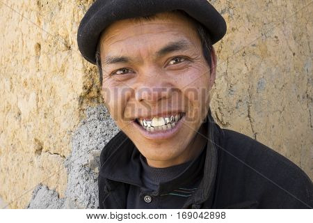 Ha Giang, Vietnam - Feb 7, 2014: Portrait of a Hmong man smiling at tourist. The Hmong are an Asian ethnic group from the mountainous regions of China, Vietnam, Laos, and Thailand