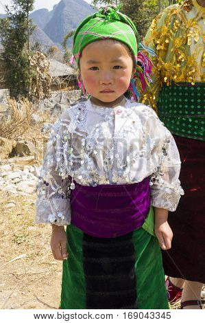 Ha Giang, Vietnam - Feb 7, 2014: Portrait of unidentified Hmong child in Ha Giang. The Hmong are an Asian ethnic group from the mountainous regions of China, Vietnam, Laos, and Thailand