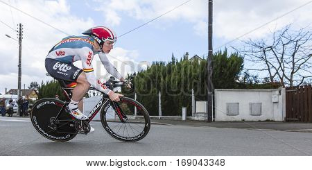 Conflans-Sainte-HonorineFrance-March 62016: The German cyclist Andre Greipel of Lotto-Soudal Team riding during the prologue stage of Paris-Nice 2016.