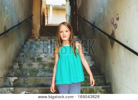 Close up portrait of a cute little girl of 7-8 years old, wearing green top