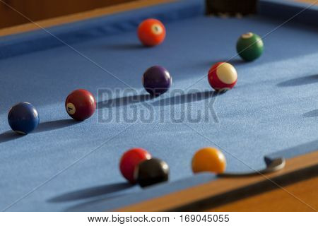 Billiard balls in a pool table. Focus on red billiard ball