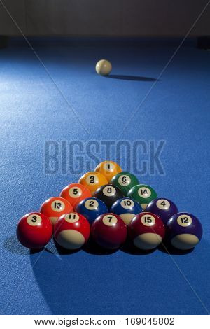 Pool billiard balls in commonly used starting position. Focus on all billiard balls