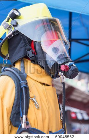 Close up Firefighters in yellow fire-proof uniform