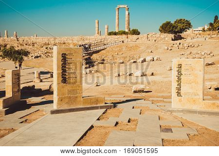 Photo of the Entry to Amman Citadel, Jabal al-Qal'a, historic site at center of downtown Amman, Jordan. Temple Hercules ruins on background. Tourism industry. Summer vacation. Travel concept. Tourist attraction.