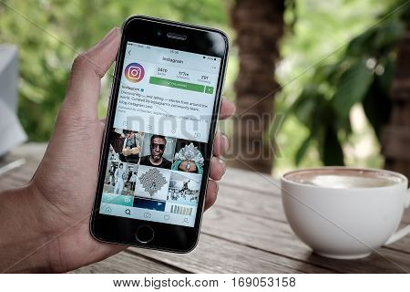 Stock Photo: CHIANG MAI THAILAND - JULY 26 2016: A man holds Iphone 6s or 6s Plus with Instagram application on the screen. Instagram is a photo-sharing app for smartphones.