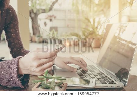 Online paymentWoman's using computer laptop and using credit card for online shopping.