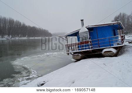 In early January 2017. Cold winter blizzard.  Pontoons,boats, forests, homes it froze. Borcea River is an ice bridge.