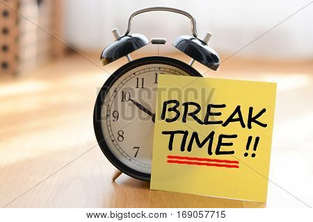 Break time concept with classic alarm clock