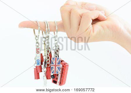 Visit London concept with woman hand holding colorful souvenir key chains