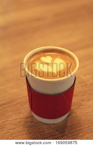 Close up of latte in a takeaway cup