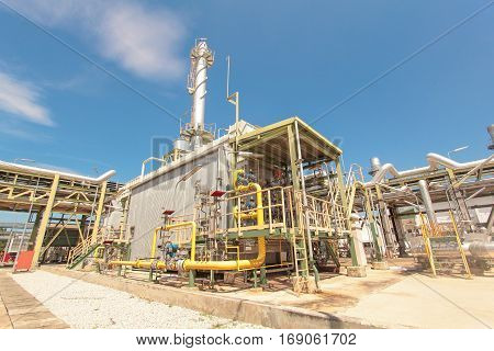 Gas Turbine in industrial power plant with blue sky