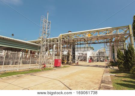 Red box and pipe line in industrial power plant with blue sky