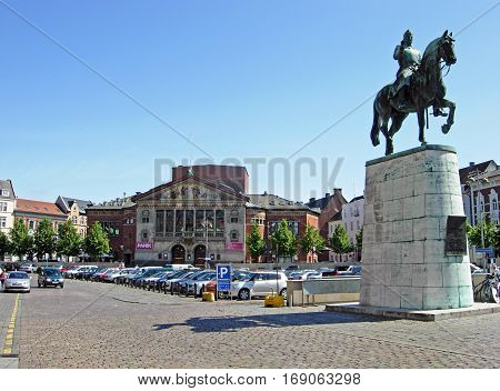 Aarhus, Denmark - June 6, 2009: Square at Aarhus Cathedral with the equestrian statue of King Christian X. In the background, the theater Aarhus Teater can be seen.