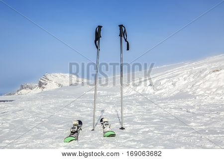 Image of skis and sticks on the snow on a high altitude ski in the Alps.